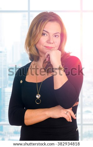 Portrait of a happy senior business woman at office - stock photo