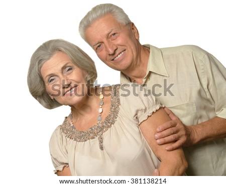 Portrait of a happy senior couple at white background - stock photo