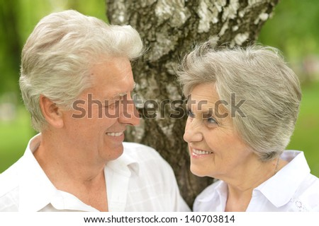 portrait of a happy senior couple in the late spring outside