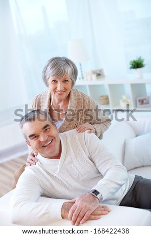 Portrait of a happy senior couple looking at camera with smiles  - stock photo