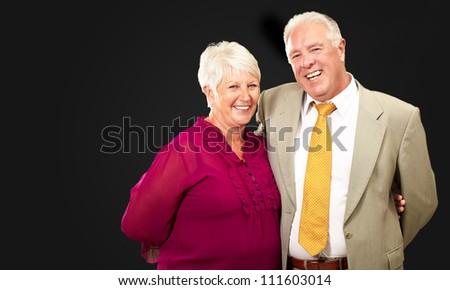 Portrait Of A Happy Senior Couple On A Black Background - stock photo