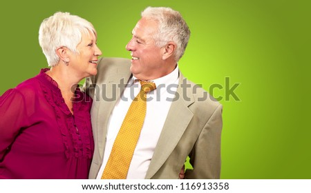 Portrait Of A Happy Senior Couple On Green Background - stock photo