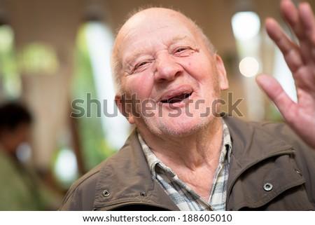 Portrait of a happy senior man   - stock photo
