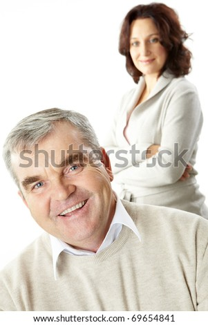 Portrait of a happy senior man and his wife standing behind
