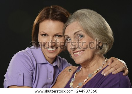 Portrait of a happy senior mother and daughter