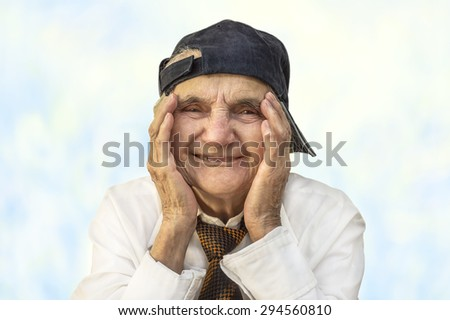 Portrait of a happy senior woman smiling at the camera. Selective focus - stock photo