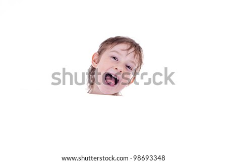 Portrait of a happy small boy holding a blank board against white background - stock photo