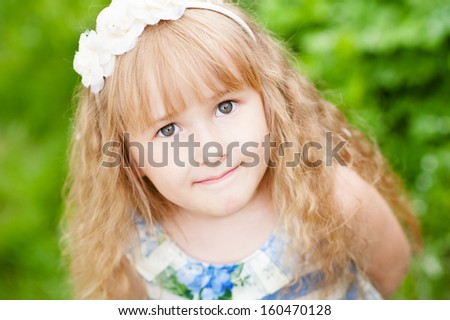 Portrait of a happy smiling cute girl - stock photo