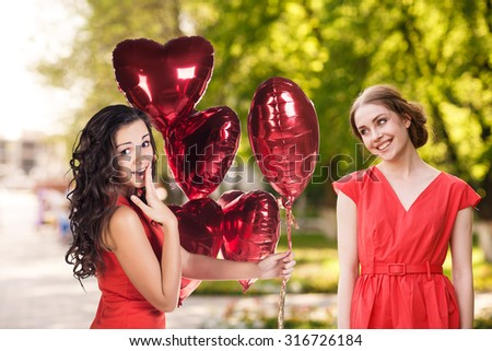 Portrait of a happy smiling girls in the park - stock photo