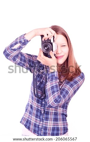 Portrait of a happy smiling teen girl photographer