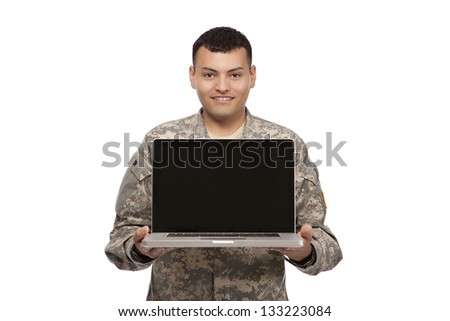 Portrait of a happy soldier with a laptop - stock photo
