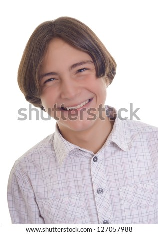 Portrait of a happy teenage boy isolated on white