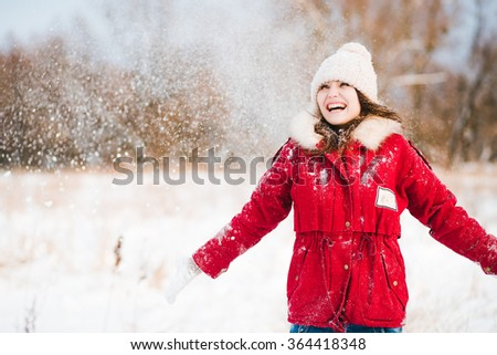 Portrait of a happy teenage girl in the snow - stock photo