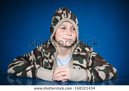 Portrait of a happy teenager on blue background - stock photo