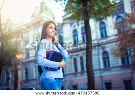 Portrait of a happy thoughtful female student