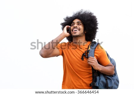 Portrait of a happy travel guy talking on mobile phone - stock photo