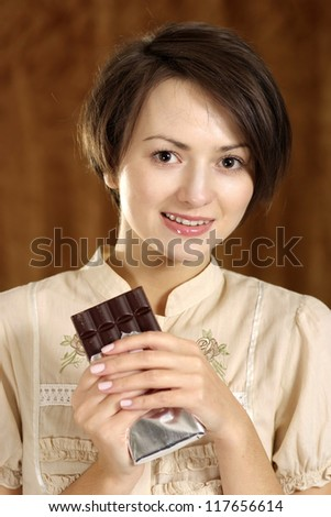 portrait of a happy woman and chocolate in his hands - stock photo
