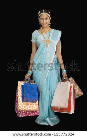 Portrait of a happy woman carrying shopping bags