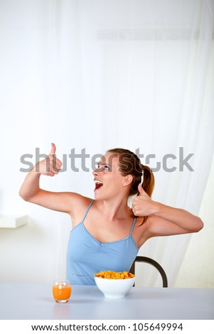 Portrait of a happy woman eating healthy breakfast at home indoor - stock photo