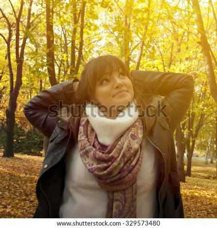 Portrait of a happy woman enjoying nature