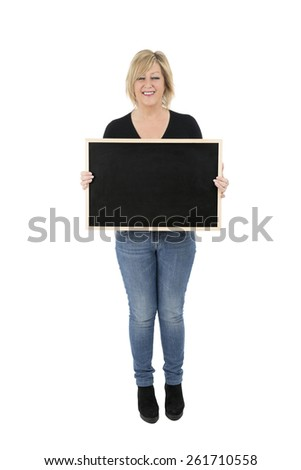 Portrait of a happy woman holding a blackboard against a white background - stock photo