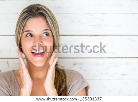 Portrait of a happy woman looking very surprised
