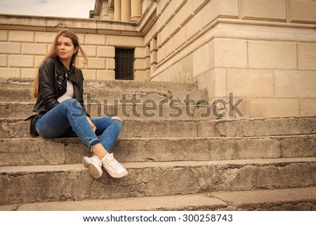 Portrait of a happy woman sitting on steps