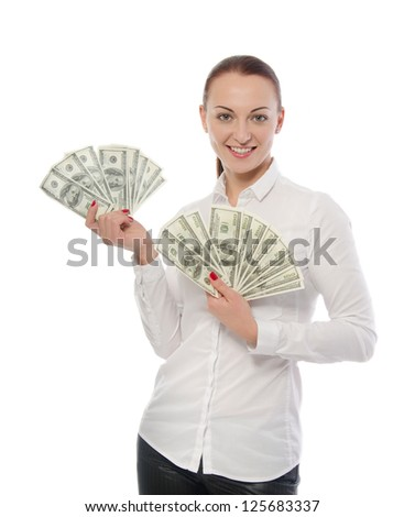 Portrait of a happy woman with a fan of American dollar currency notes, isolated on white background