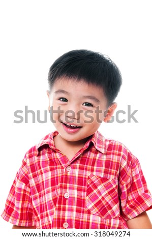 Portrait of a happy young Asian boy against white background.