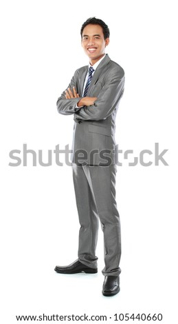 Portrait of a happy young asian businessman smiling on white background