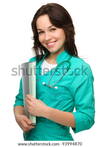 Portrait of a happy young attractive woman wearing doctor uniform, isolated over white - stock photo