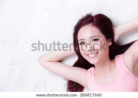 portrait of a Happy young beautiful woman relax lying and look to empty area in the image, great for your design, asian beauty - stock photo