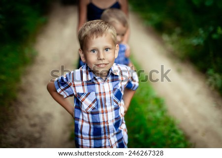 Portrait of a happy young boy outside  - stock photo
