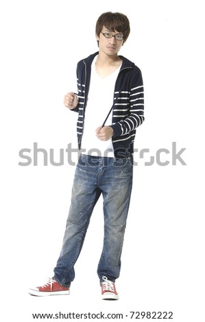 Portrait of a happy young boy standing against isolated white background