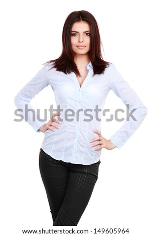 Portrait of a happy young business woman in blue shirt against white - stock photo