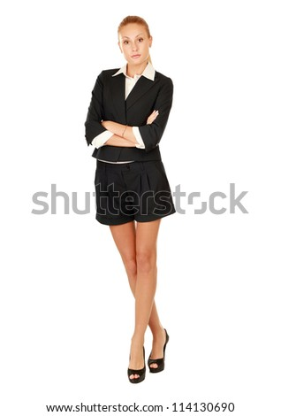 Portrait of a happy young business woman standing full lenght white background - stock photo