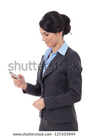 portrait of a happy young business woman texting from her cellphone against white background - stock photo