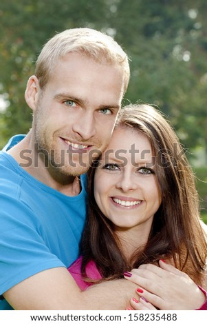 portrait of a happy young couple smiling.