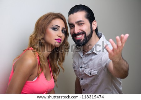 Portrait of a happy young couple standing together - stock photo
