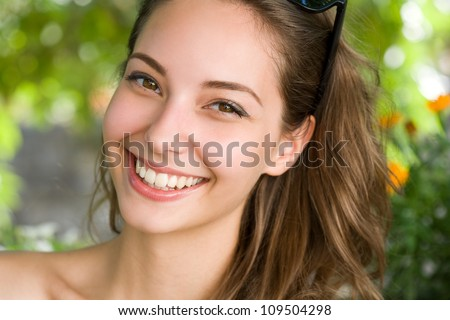Portrait of a happy young fun brunette woman with amazing smile. - stock photo