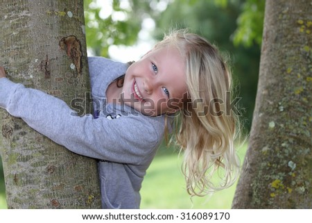 Portrait of a happy young girl outdoors - stock photo