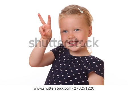 Portrait of a happy young girl showing victory sign on white background - stock photo