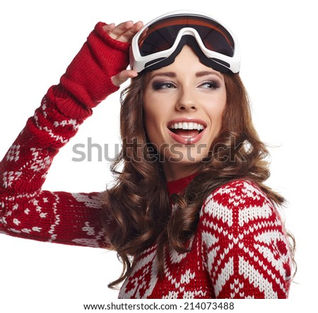 Portrait of a happy young girl snowboarding  - stock photo