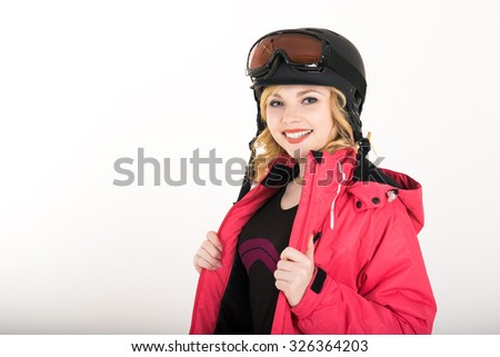 Portrait of a happy young girl snowboarding. beautiful young girl sportswoman. girl in a helmet and a red blazer, woman snowboarding