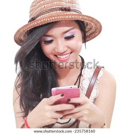 portrait of a happy young girl was playing mobile phone, isolated on white background - stock photo