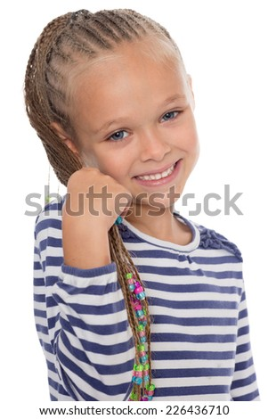 Portrait of a happy young girl with dreadlocks. The girl is six years old.  - stock photo