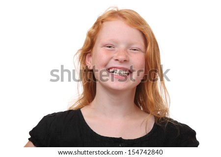 Portrait of a happy young girl with freckles on white background - stock photo