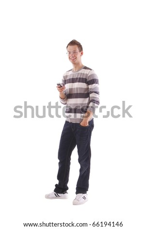 Portrait of a happy young guy with cellphone - stock photo