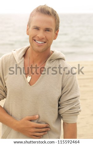 Portrait of a happy young man laughing and relaxing - stock photo