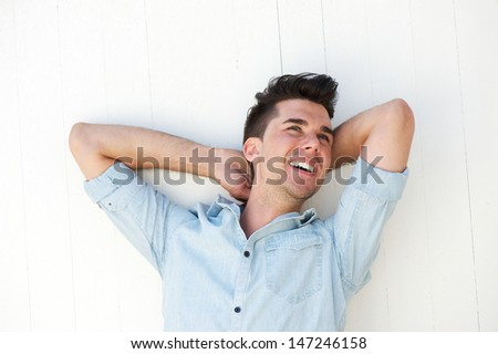 Portrait of a happy young man laughing outdoors